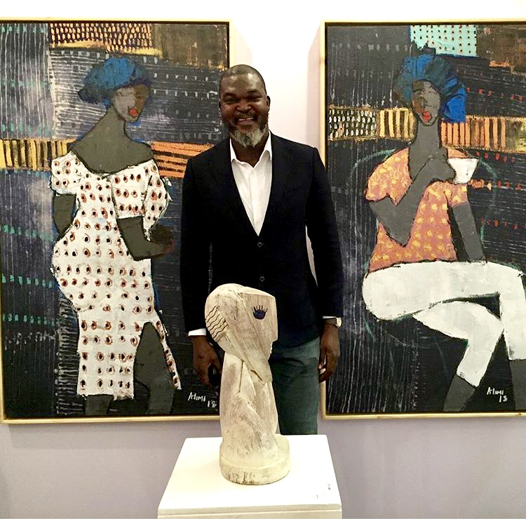 Artist Alimi Adewale in front of his paintings, Courtesy Arthouse Contemporary, ART X Lagos